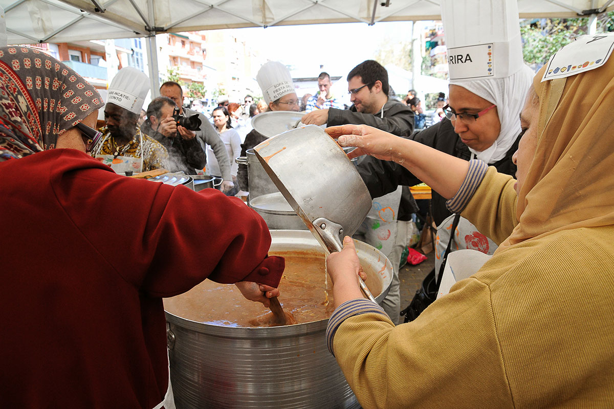 "A group of women from Nou Barris in Barcelona prepare harira (traditional Moroccan spiced soup) at the neighborhood's Festival de Sopes del Món (""Soups of the World Festival"")."