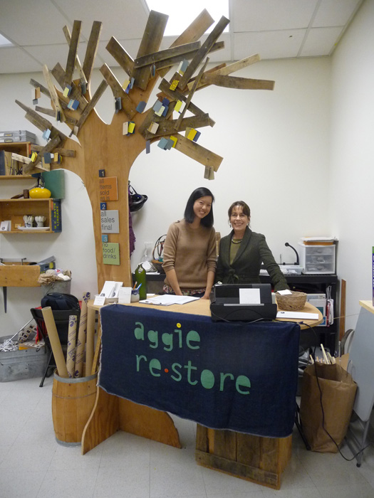 Dr. Ann Savageau and her student Carol Shu pose at the check-out area of the Aggie Restore Shop.