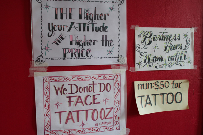 Helpful signage at the check-in counter at Nu Flava Ink Tattooz. Photo by Jennie Terman