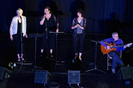 NOKA singers Cathy Petrissans, Andrea Bidart, and Begoña Echeverría were accompanied by Basque guitar player Mikel Markez at the 2016 Folklife Festival. Photo by Josh Weilepp, Ralph Rinzler Folklife Archives