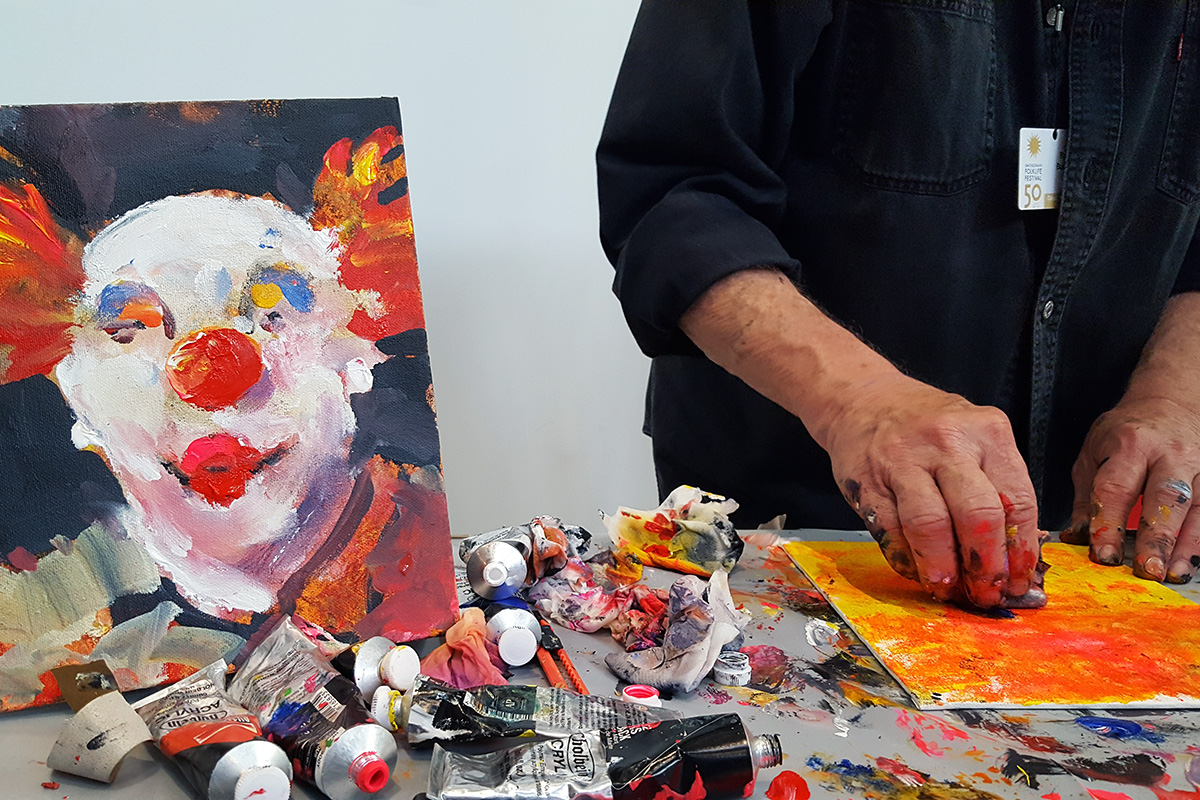 Robert Burridge gives a painting demonstration in the Festival Marketplace. Photo by Elisa Hough