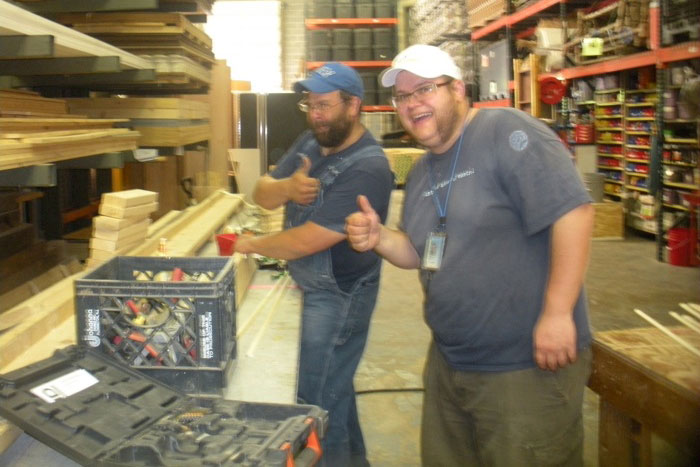 Safety check before using the circular saw with carpenter Josh Herndon (left) and exhibit worker Tim Bergstrom (right).