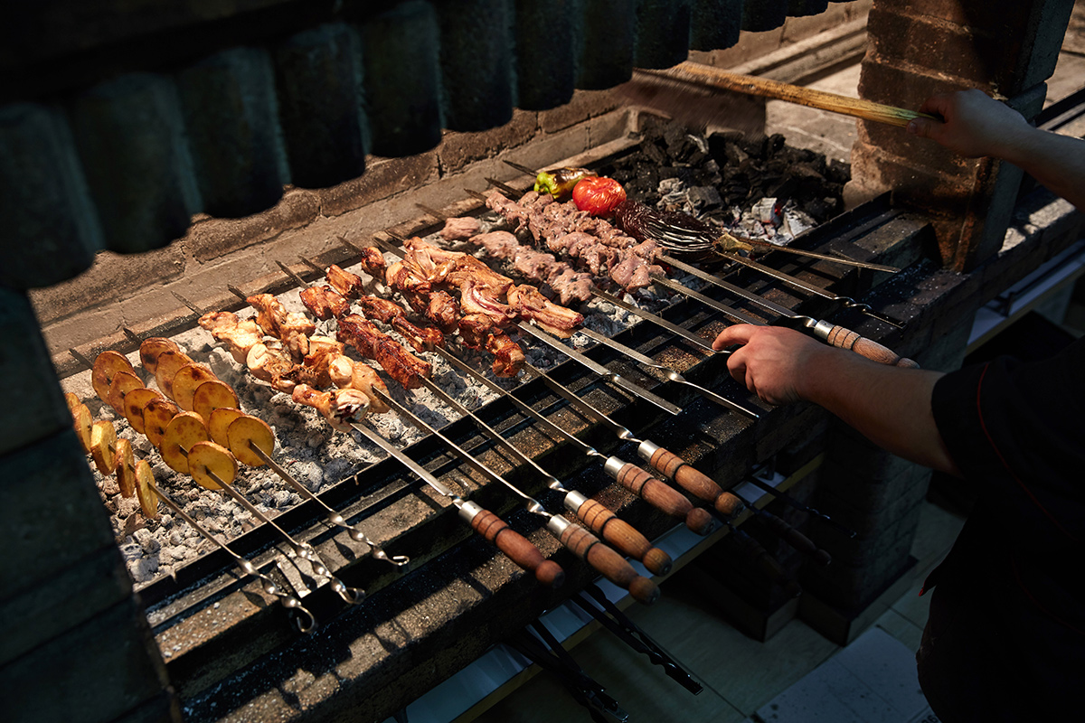 A cook works on khorovats skewers at Taron Restaurant in Yerevan. Photo by John Lee