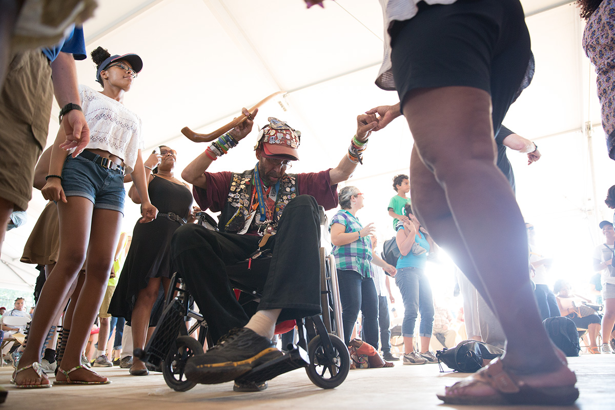 Visitors dance during the Chuck Brown Band's performance at the 2017 Folklife Festival. Photo by Daniel Martinez, Ralph Rinzler Folklife Archives