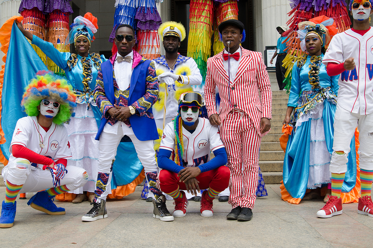 Lucky Malatsi (in blue jacket with pink collar) joins fellow UniverSoul Circus performers on the steps of the Smithsonian's National Museum of Natural History. Photo by Josh Weilepp, Ralph Rinzler Folklife Archives