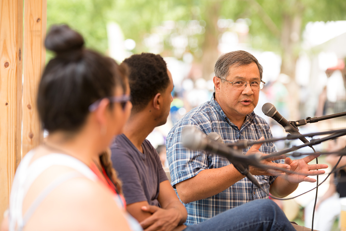 Tong Gong addresses panelists at the 2017 Folklife Festival. Photo by Pruitt Allen, Ralph Rinzler Folklife Archives