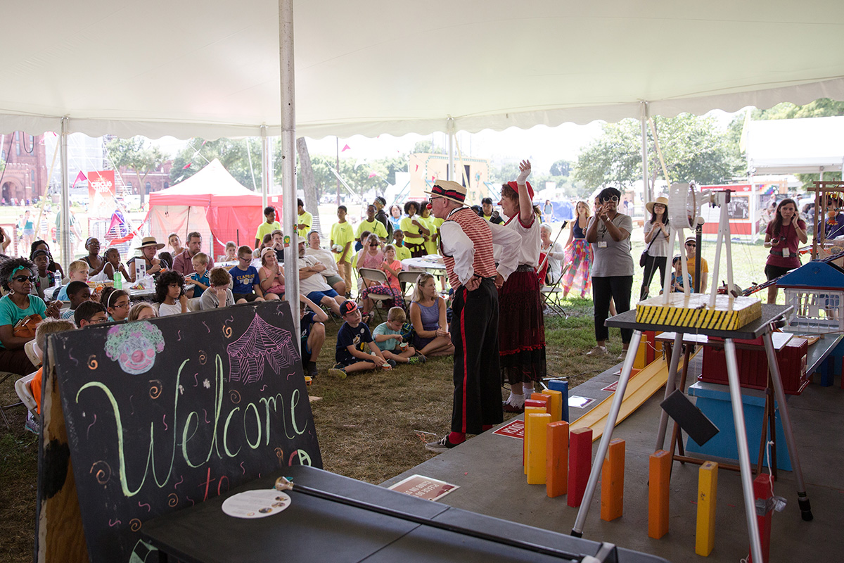 Robin Eurich and Karen Bell introduce the Marvelous, Miraculous Circus Machine to a full crowd in the Circus Science tent. Photo by Daniel Martinez, Ralph Rinzler Folklife Archives