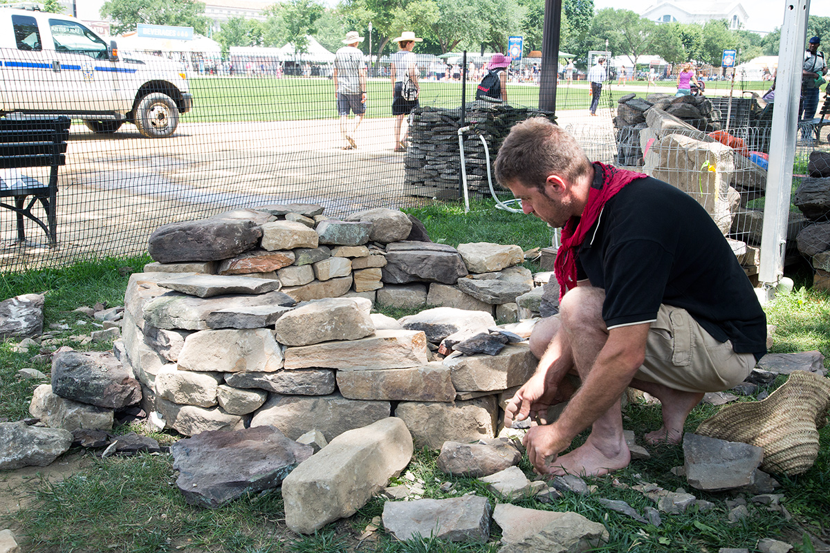 Roger Solé-Coromina building a dry-stone structure at the 2018 Smithsonian Folklife Festival. Photo by Jennifer Berry, Ralph Rinzler Folklife Archives