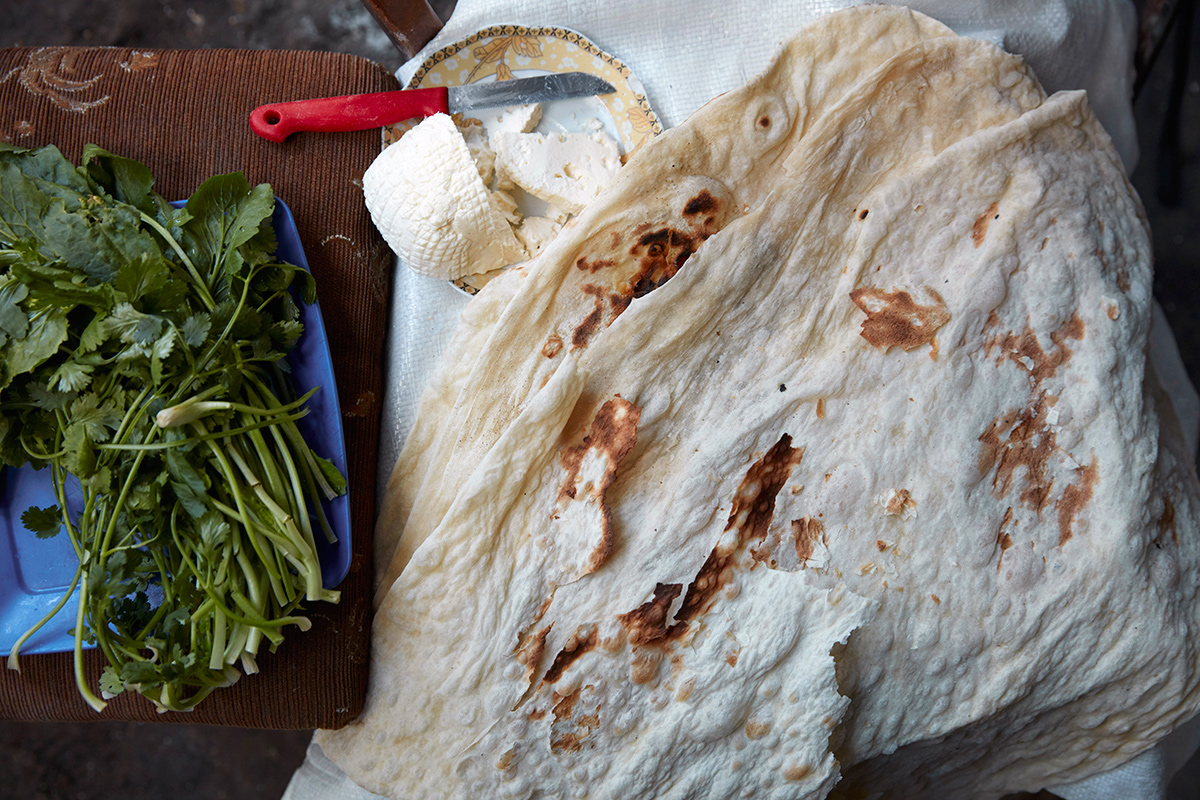 In Yeghvard, Armenia, home bakers offered us a platter of cheese and herbs to eat with the fresh lavash. Photo by John Lee
