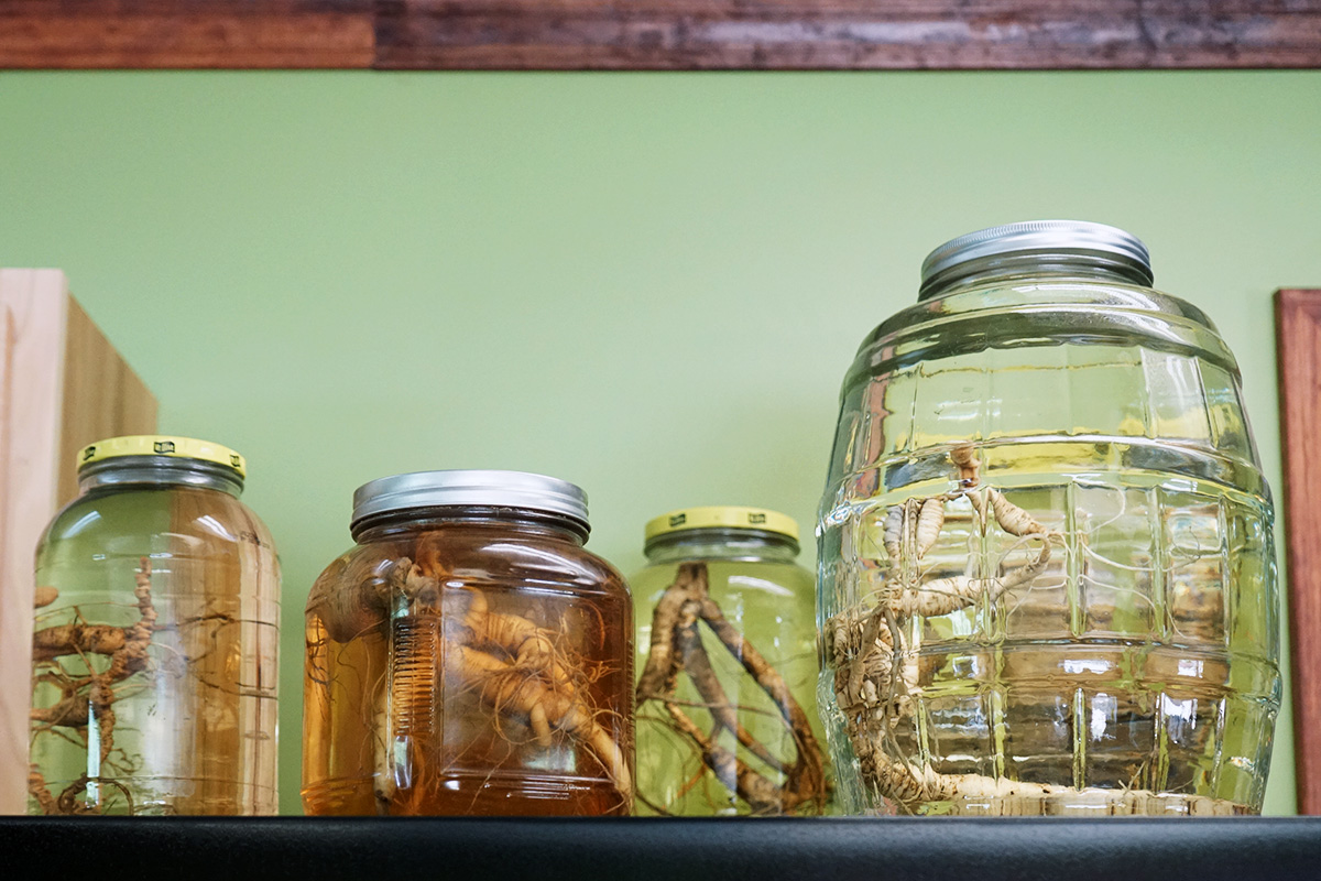 Some choice wild American ginseng roots are proudly displayed in jars with preservative in Tony Coffman's office. Photo by Arlene Reiniger