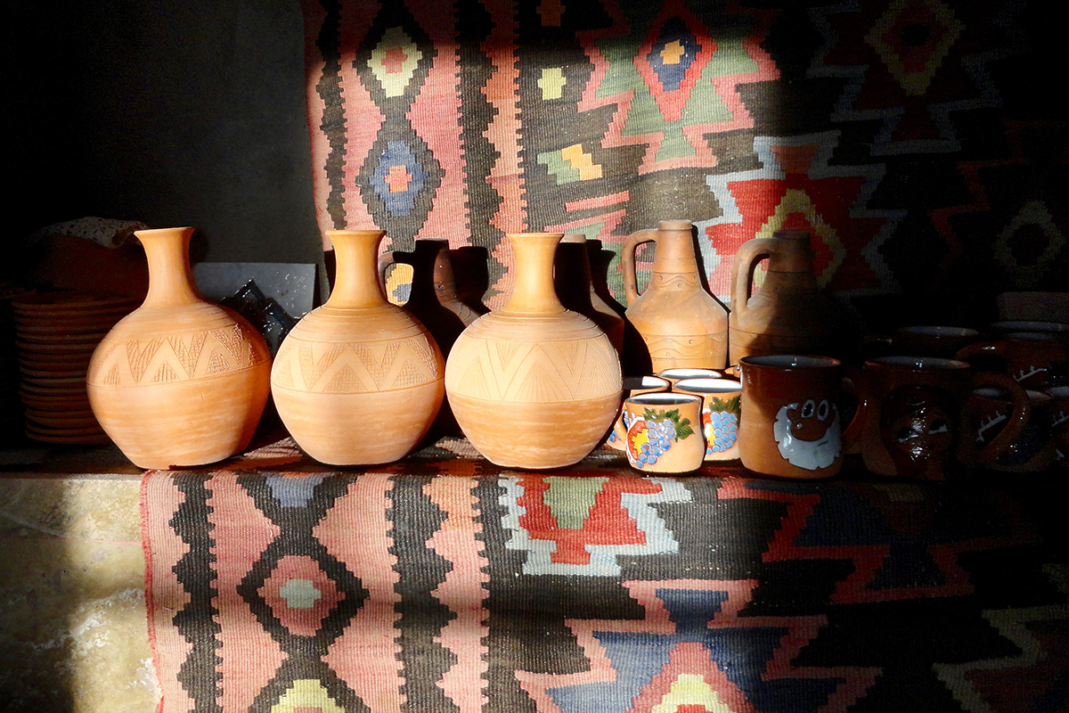 At Sisian Ceramics, Vahagn Hambardzumyan throws clay on a wheel to make traditional Armenian shapes onto which Zara Gasparyan etches decorative patterns. The terracotta jugs on the left are made to hold water. Photo by Jackie Flanagan Pangelinan, Smithsonian