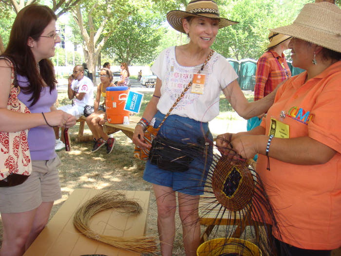 Colombia program curator Olivia Cadaval (center) with basket weaver Areli Hernández Vega (right) and a Festival visitor