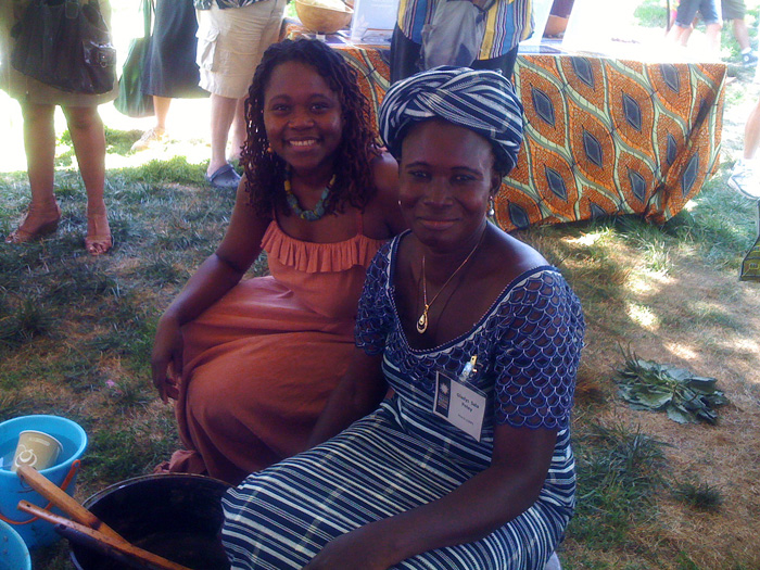 Rahama Wright (left) with Gladys Sala Petey, who supervises production teams in Ghana, take a break from their demonstrations in the Peace Corps program of the 2011 Festival