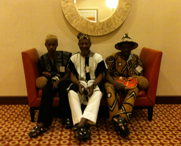 Issa Téssougué, Simbè Sankaré, and Moussa Fofana of Mali await the Peace Corps reception