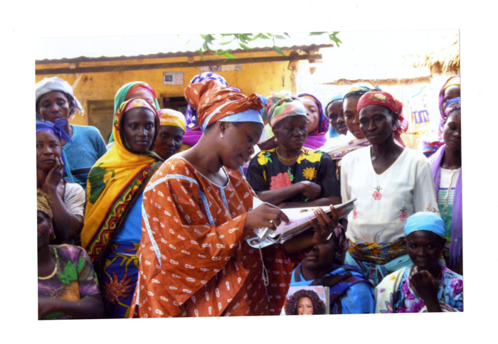 Rahama Wright (center) meets with some of the women in northern Ghana who produce shea butter for cosmetic products
