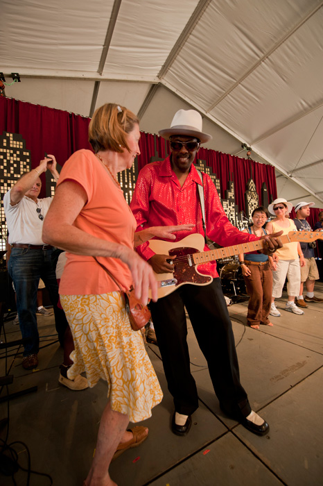 Fernando Jones dances with a visitor in the Motor City tent.