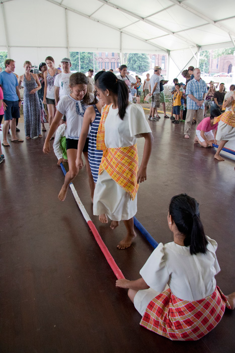 Members of the The Rehoboth Children's Home Dance Team invite the audience to try tinikling dancing.
