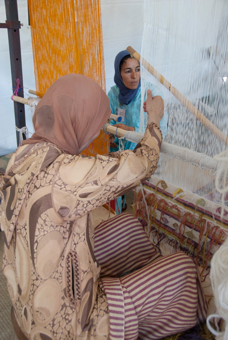 Fatima Akachmar (left) and Khadija Ighilnassaf demonstrate Moroccan weaving