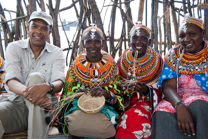 Peace Corps director Aaron Williams with Ngurunit Basket Weavers Group members (from left to right) Nkerisapo Lewano, Nankaya Lebitilig, and Lilian Lekadaa
