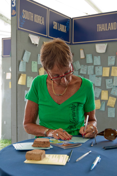 A Festival visitor writes a message to leave at the RPCVillage, a space where returned Peace Corps volunteers are sharing and exchanging messages
