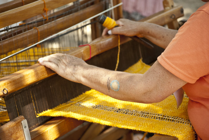 Ana Dolores Russi Suárez weaves at her loom in the Andean Highlands section of the Colombia program