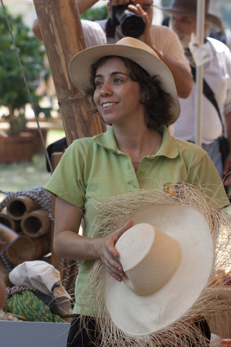 Colombia program presenter Olga Costa helps with a demonstration about hat weaving.