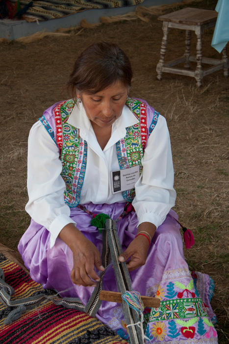Danitza Lourdes Ramos de Gonzalez of Callalli, Peru, demonstrates weaving in the Peace Corps program.