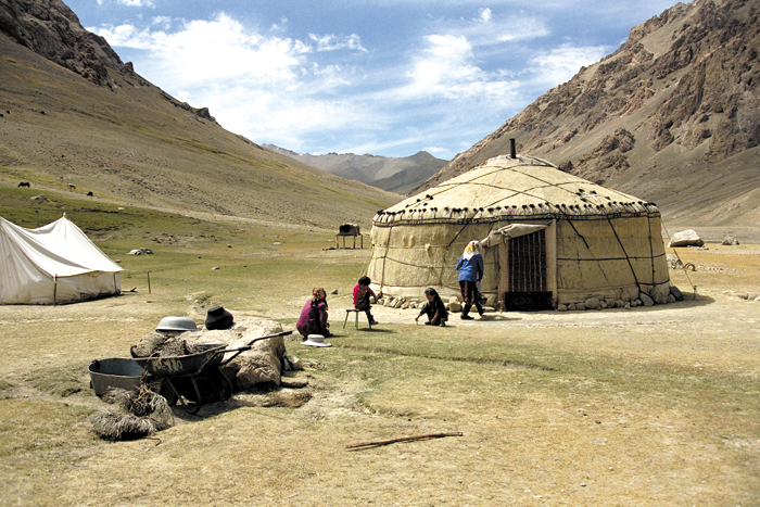 This family has set up camp with their yurt in Tajikistan.
