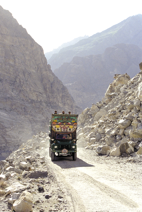 A decorated Pakistani cargo truck travels the Karakoram Highway towards China. These trucks move along the same routes taken by Silk Road travelers for thousands of years.