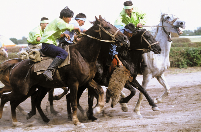 A game of polo is played in Susoom, Pakistan, in 1985.