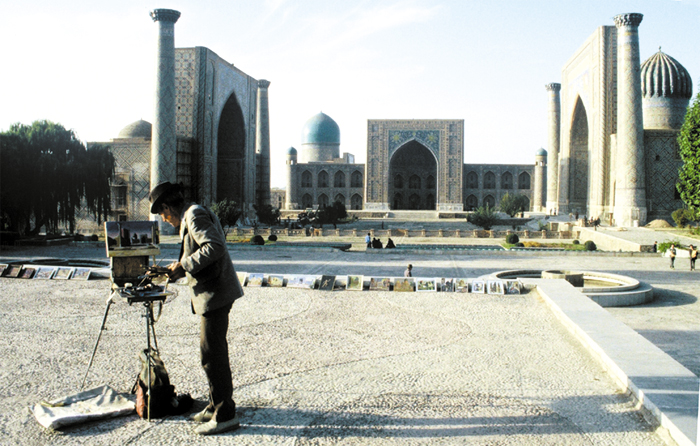 An artist paints at Registan Square in Samarkand.