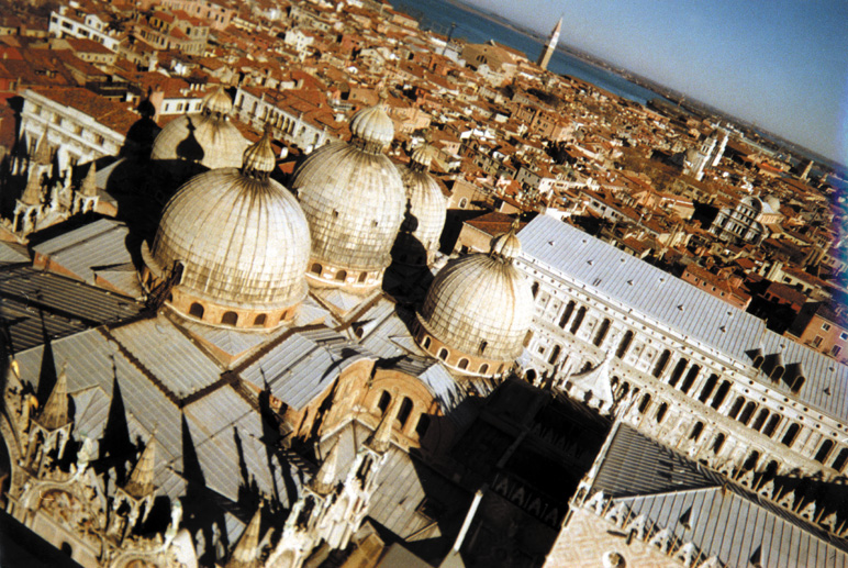 This view from the Campanile on St. Mark's Square looks across Venice from the Basilica towards the Arsenale. The Arsenale was the huge compound where ships of the Venetian fleet were built and refurbished. Houses from the 13th century are still inhabited in this section of the city.