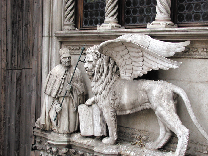 Francesco Foscari, a 15th-century doge of Venice, kneels before the Lion of St. Mark that is over the entrance to the Doge's Palace. The lion is the symbol of the city.