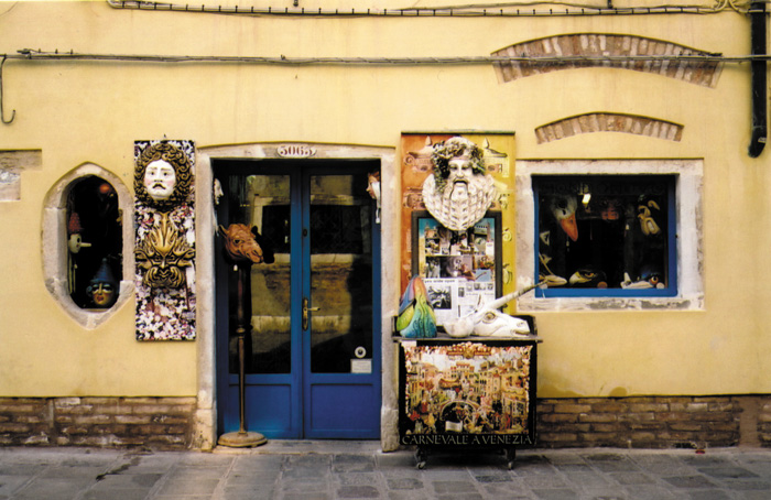 Small shops dot the lanes in Venice and represent the long-standing commercial activity of the city. This shop sells the famous masks worn during the annual Venice Carnival.