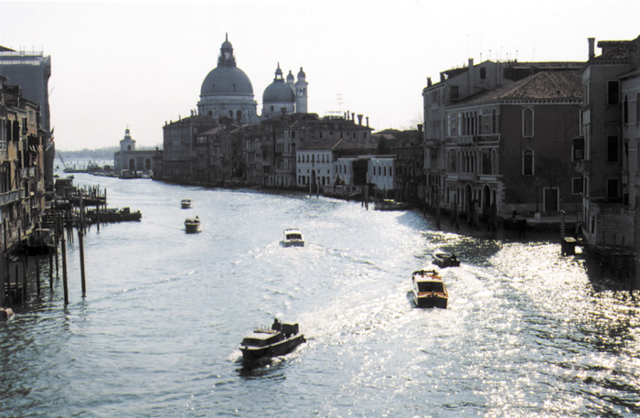 Motorized <i>vaporetti</i> now ply the Grand Canal that snakes through the center of Venice. The great houses of Venetian merchants line the canal.