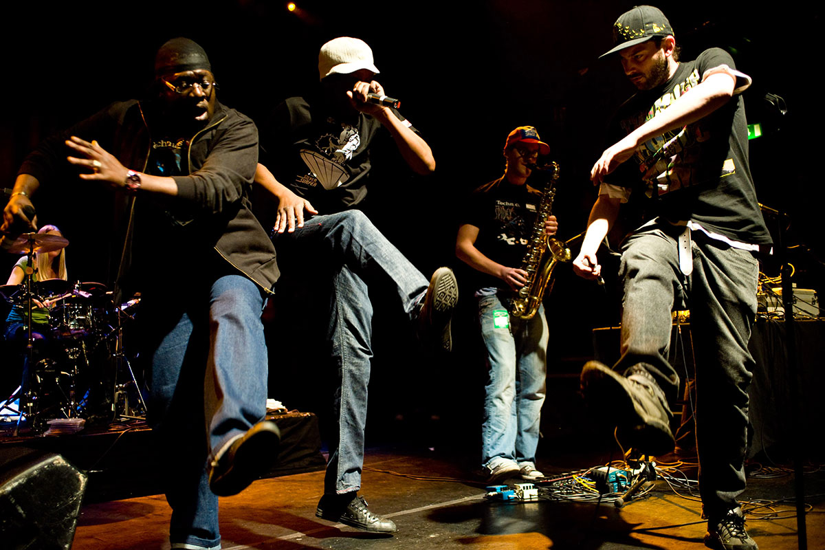Rappers and hip-hop artists, such as Roots Manuva (shown here in white hat), are vital elements of African American oral culture.