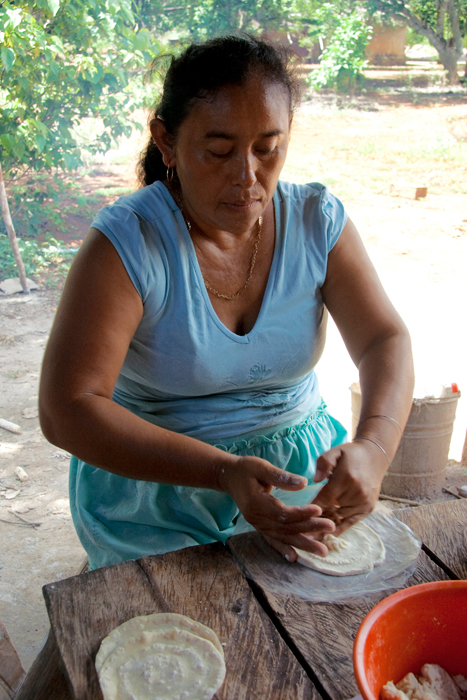Alejandra Vera makes corn tortillas by hand at lunchtime in the communal lands of Santa Rosa Xtampak, Campeche.