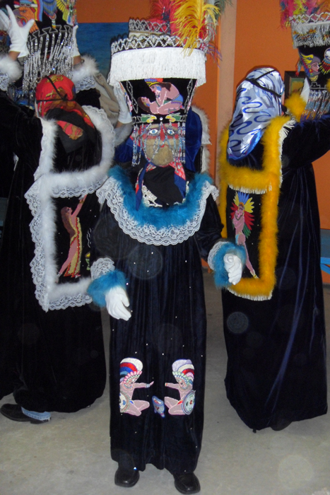 A costumed Chinelo dancer.