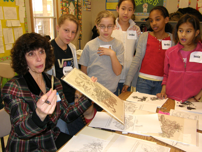 Alice Tangherini, staff illustrator for the National Museum of Natural History's Department of Botany, shows fifth-graders some of her work during the 2009 Big Draw art event at North Chevy Chase Elementary School in Maryland.
