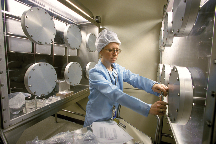 Linda Welzenbach, a geologist with the National Museum of Natural History's Department of Mineral Sciences, works in the Antarctic meteorite storage facility at the Smithsonian's Museum Support Center in Silver Hill, Maryland.