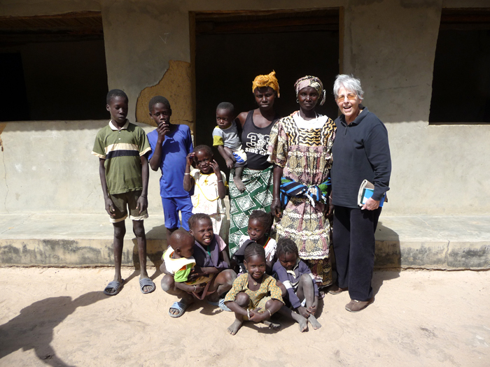 Olga Linares, an anthropologist with the Smithsonian Tropical Research Institute, studies changes in rice production and the future potential of the crop. She is pictured here with a Jola family in Senegal.