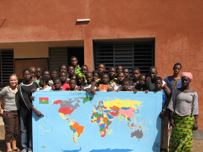 Peace Corps volunteer Stephanie Gottlieb and the world map drawn by her students in Burkina Faso.