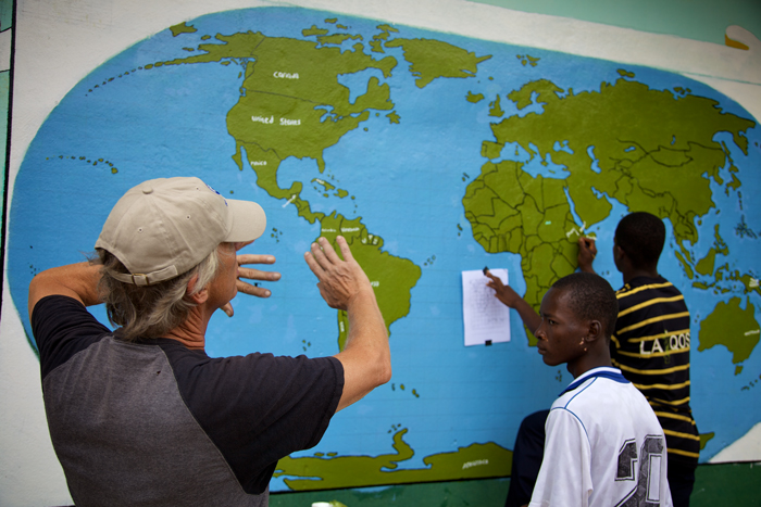 Peace Corps volunteer Edward Solem and the world map drawn by his students in Liberia.
