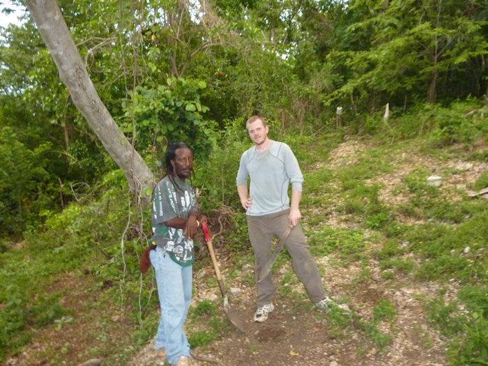 Brian Wedderburn (standing at left), president of the Bluefields Organic Farmers Group, and Patrick Marti, Peace Corps volunteer, prepare a small organic plot for planting.