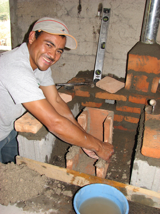 In Guacerique, Honduras, Victor Manuel Avila Gonzales builds a ceramic combustion chamber for a fuel-efficient cookstove. By containing and directing the flame, the combustion chamber may reduce firewood usage by up to 70 percent.