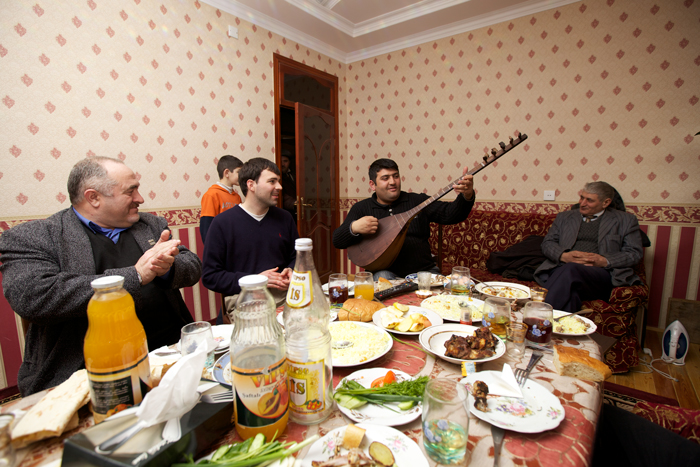 Peace Corps volunteer Tim McNaught eats, drinks, and socializes with his host family in Azerbaijan.