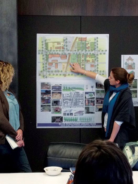 Iowa State University College of Design students use maps to discuss design problems with community members; in this case, the issue was to rebuild sustainably the neighborhoods in Cedar Rapids damaged by flooding.