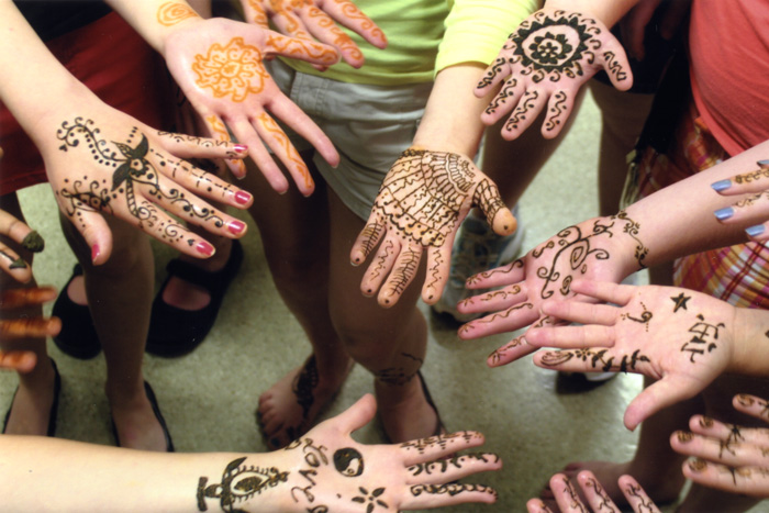 Traditional art adorns the hands of FOLKPATTERNS participants.