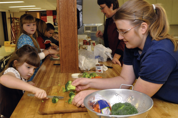 "Missouri University's Family Nutrition Program offers a ""cooking camp"" to teach children about healthy eating. Children from Gasconade County Clover Kids Club, at St. John's United Church of Christ in Bern, Missouri, learned to properly cut their vegetables."