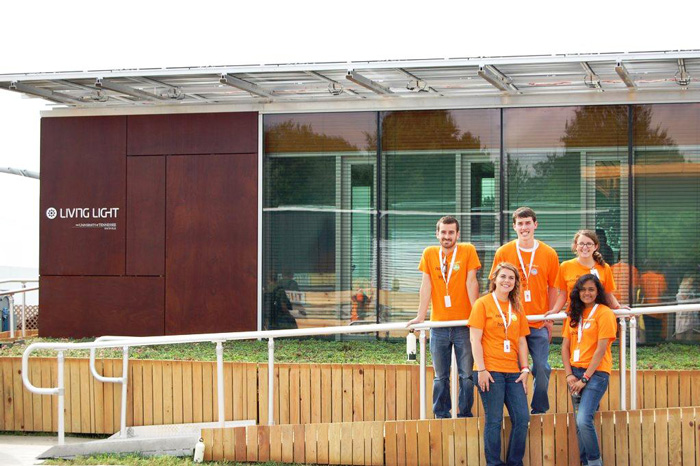 At the 2011 U.S. Department of Energy Solar Decathlon, students of the University of Tennessee, Knoxville, pose with the Living Light House. More than two hundred UT students across nine academic disciplines helped produce this innovative solar-powered home.